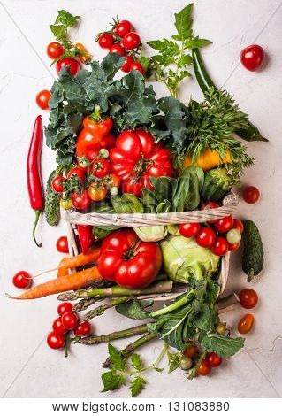 Basket of fresh vegetables on the white background. Top view