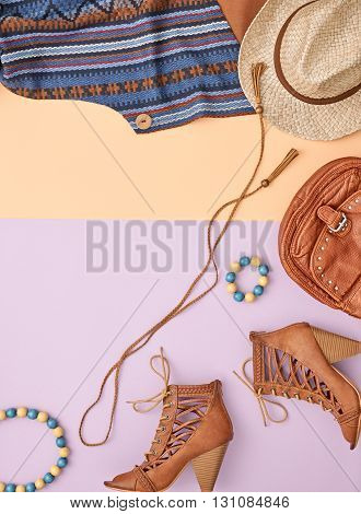 Urban country creative outfit. Cowboy street style Fashion girl clothes accessories set. Hipster woman, trendy handbag, shoes, straw hat, necklace. Overhead, top view on pink yellow