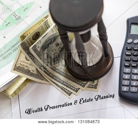 Sepia shaded image of Wealth Preservation & Estate Planning - legal statement. Hourglass calculator and hundred dollar bills on financial pages of broadsheet newspaper.