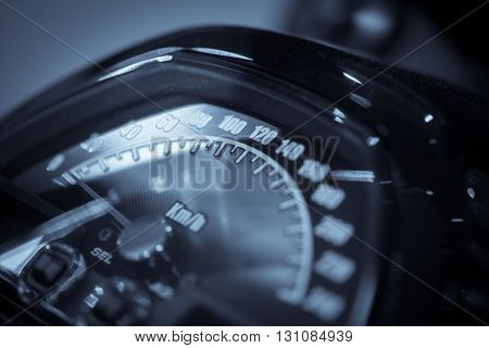Close up shot of a motorcycle speedometer.
