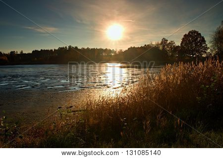 Sunset Above Empty Lake, Reeds And Reflections On The Shore. Beautiful Summer Landscape.