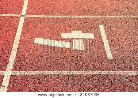 Number Four. White Track Number On Red Rubber Racetrack, Texture Of Running Racetracks In Stadium