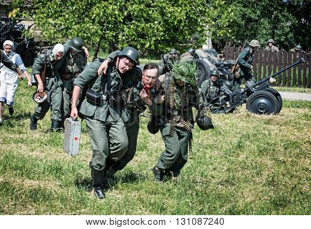 NITRA SLOVAK REPUBLIC - MAY 21: Reconstruction of the Second World War operations between Red and German army rescue of wounded german soldiers on the battlefield on May 21 2016 in Nitra Slovak Republic.