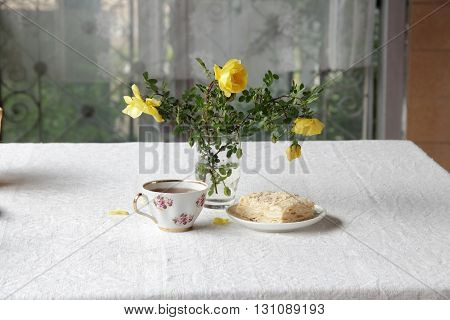 tea in a Cup and puff pastry with cream