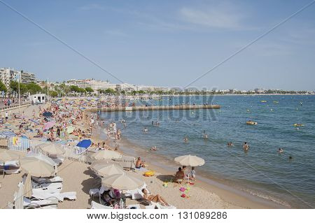 France, Cannes - August 6, 2013: A Lot Of People On The Beach Of La Croisette.