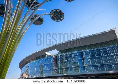 Milan Italy - February 10 2015: Porta Nuova the Solar Tree with the Porta Nuova building in the background