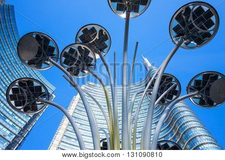 Milan Italy - February 10 2015: Porta Nuova the Solar Tree with the Unicredit Tower in the background