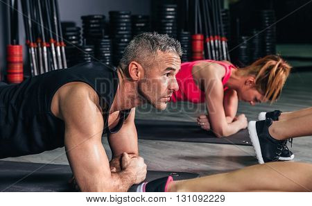 Close up of man doing push ups in fitness class on sports center