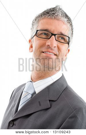 Portrait of happy businessman wearing gray suit and glasses, smiling. Isolated on white background.