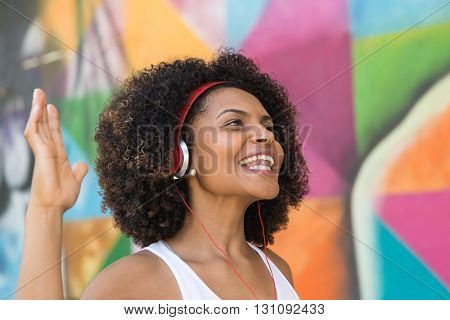 Latin woman listen music in the street