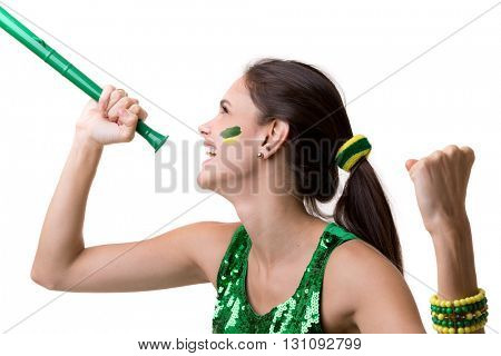 Brazilian woman fan blowing by vuvuzela on white background