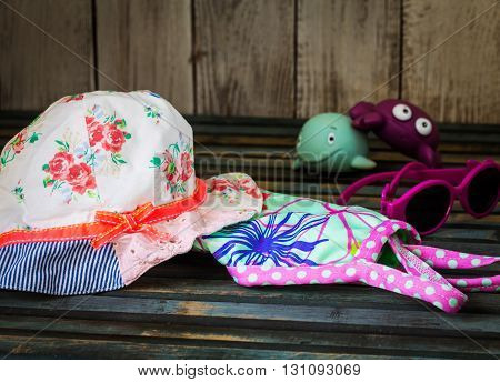 baby stuff to the beach on a beautiful wooden background
