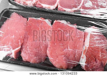 Packed pieces of pork and beef meat, close up