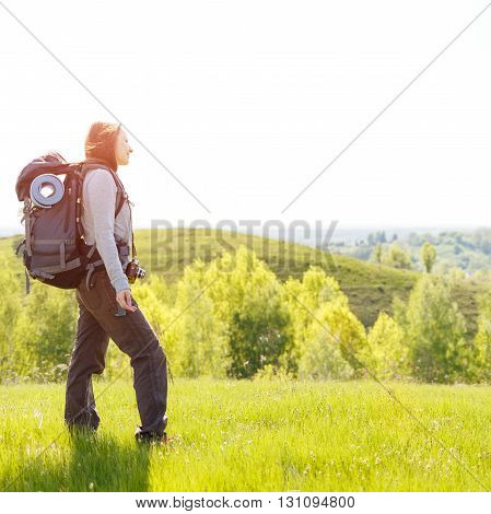 Young Hiker Woman With Backpack Standing On Hill