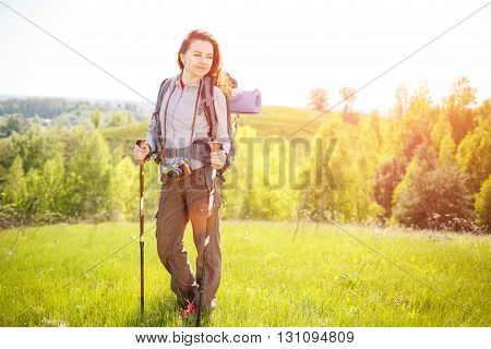 Young Hiker Woman With Backpack Walking On Hills