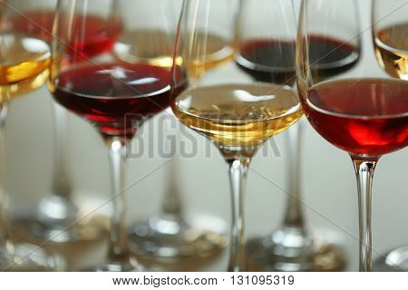 Many glasses of different wine in a row, close up