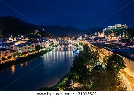 Great  view from the top on an evening city shining in the lights. Dramatic scene. Location famous place (unesco heritage) Festung Hohensalzburg, Salzburger Land, Austria, Europe. Beauty world.