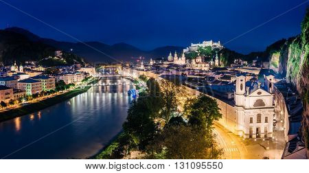 Panoramic view from the top on an evening city shining in the lights. Dramatic scene. Location famous place (unesco heritage) Festung Hohensalzburg, Salzburger Land, Austria, Europe. Beauty world.