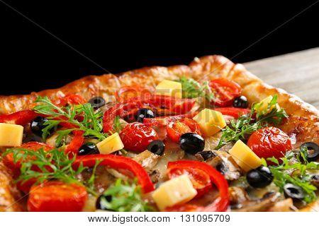 Freshly homemade pizza on black background