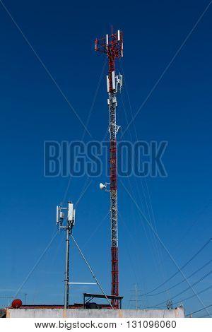 Telecommunication Radio antenna tower with blue sky.