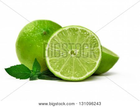 Fresh limes and mint leaves, isolated on white