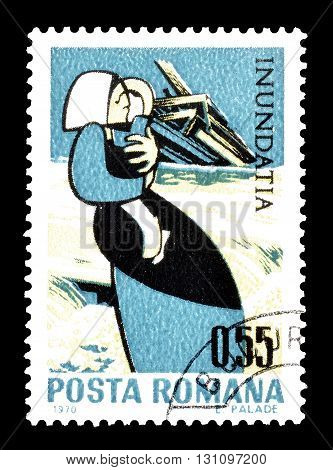 ROMANIA - CIRCA 1970 : Cancelled postage stamp printed by Romania, that shows woman holding a child in front of ruins.
