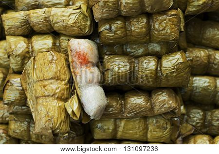 Glutinous rice steamed in banana leaf (Khao Tom Mat) bananas and sticky rice inside