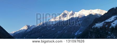 Panoramatic view on Stubai Alpen mountain range in morning