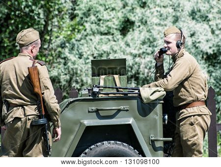 NITRA SLOVAK REPUBLIC - MAY 21: Reconstruction of the Second World War operations between Red and German army two russian soldiers communicate by the radio with headquarters on May 21 2016 in Nitra Slovak Republic.