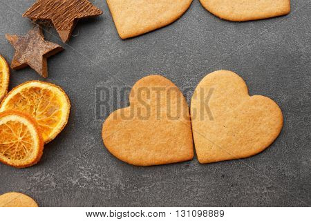 Heart shaped biscuits on grey background, top view