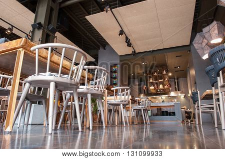 Low angle of tables and chairs on floor in modern restaurant