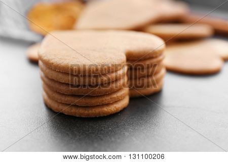 Heart shaped biscuits on grey table, closeup