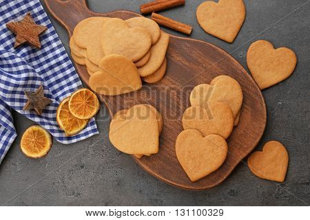 Heart shaped biscuits on cutting board, closeup