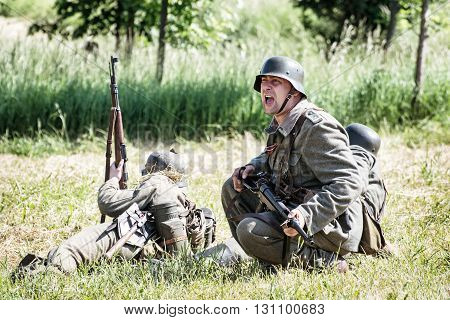 NITRA SLOVAK REPUBLIC - MAY 21: Reconstruction of the Second World War operations between Red and German army german noncommissioned officer summons reinforce to the combat zone on May 21 2016 in Nitra Slovak Republic.