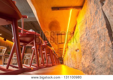Contemporary restaurant with special interior. Low angle of chairs under the bar counter