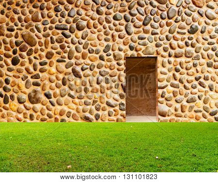 Stone Wall With Door And Grass Floor In Front Off