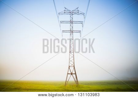 High Voltage Pole With Light Morning Fog