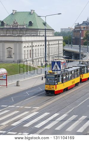 Poland Warsaw - JULY 8 2012: Roadway tram and a tram stop in the Old Town of Warsaw.