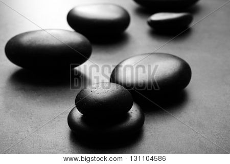 Heap of spa hot stones  on grey background