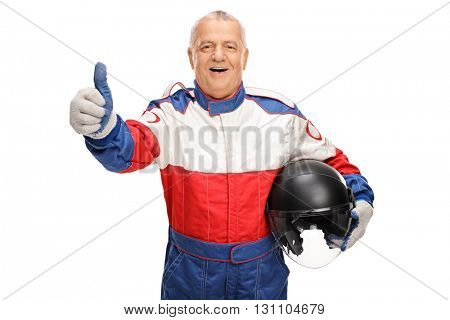 Mature car racer giving a thumb up and holding a helmet isolated on white background