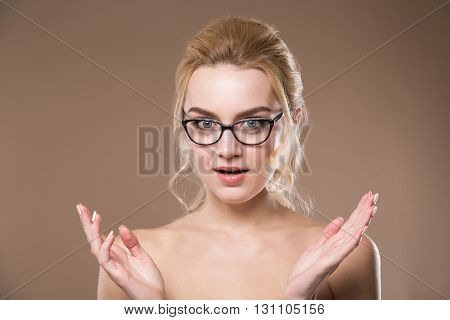 Surprised Young Lady In Glasses