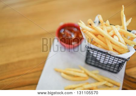 French fries on wood table
