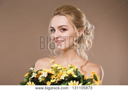 Blonde With Flowers In Their Hands
