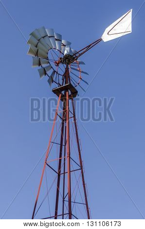 Old Antique Aermotor Windmill Used To Pump Water And Beautiful Blue Sky