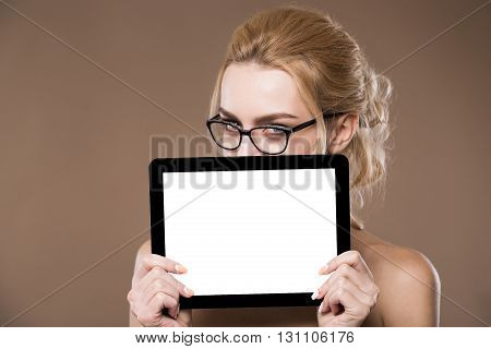 Portrait Of Blonde In Glasses With A Tablet In Hands