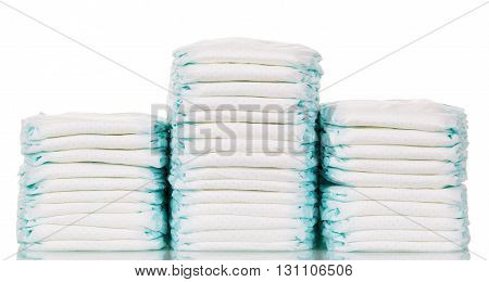 A stack of diapers isolated on a white background.