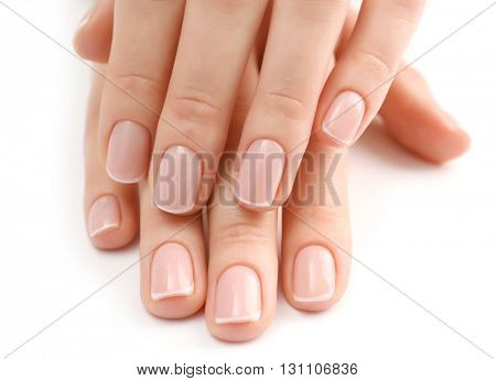 Woman hands with beautiful manicure isolated on white background