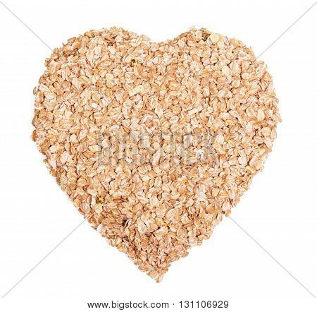Oat flakes in a heart shape isolated on white background.
