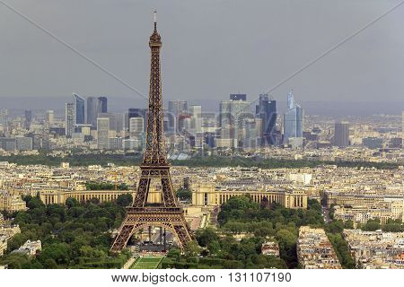 Paris, France - May 14: This is aerial view of city landmarks - the Eiffel Tower and region Defanse May 14, 2013 in Paris, France.