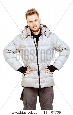 Young man in a winter jacket. Isolated over white.